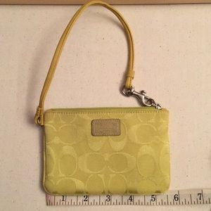 Coach wristlet - greenish yellow in color